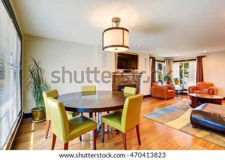 Living room interior with fireplace and dining area with green chairs. Northwest, USA