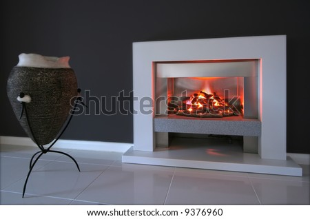 Living room interior with fireplace in contemporary home - stock photo