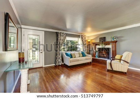 Living Room Interior With Polished Hardwood Floor Gray Walls Fireplace With Wooden Carved Trim