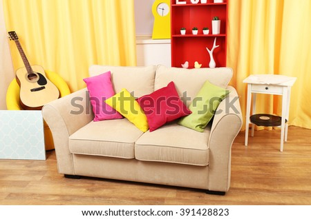 Living room interior with sofa and coloured pillows