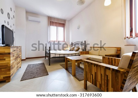 Living room interior with wooden furniture
