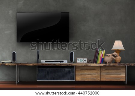 Living room led tv on concrete wall with wooden table media furniture modern loft style - stock photo