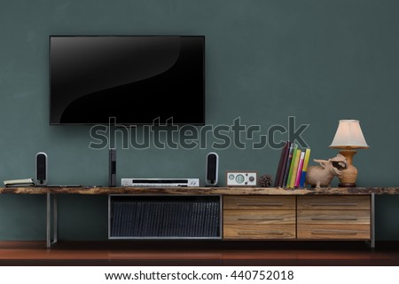 Living room led tv on dark green wall with wooden table media furniture modern loft style - stock photo