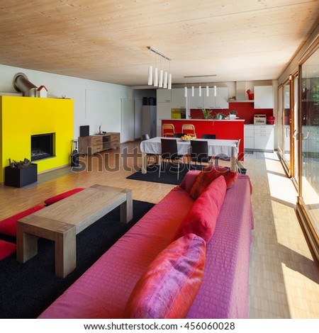 Living room of an eco house, red divan - stock photo