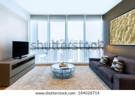 living room with big window and TV interior - stock photo