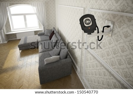 Living room with cctv camera and grey sofa - stock photo