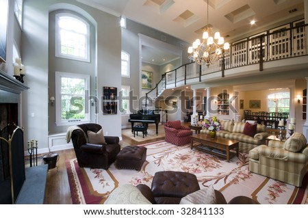 Living Room With Fireplace And French Doors In Luxury Estate Mansion Home
