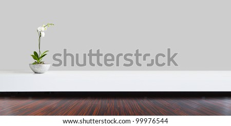 Living room with grey wall and orchid with plane space - stock photo