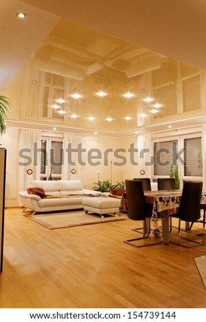 Living room with halogen lighting at the night. - stock photo