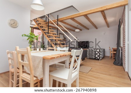 living room with kitchen and dining area - stock photo