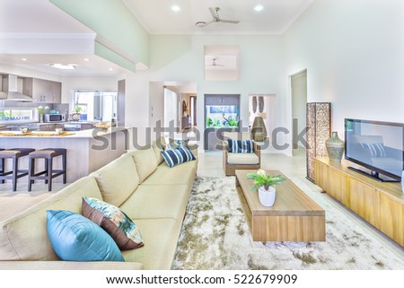 Living Room With Luxury Look Near Kitchen Wooden Dining Table And Sofa Close To Walls