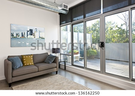 Living room with sliding glass door to balcony - stock photo