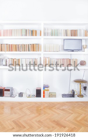 living room with tv and bookcase rendering, domestic atmosphere, library background indoors, clean and modern decoration - stock photo