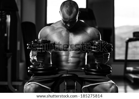 Living Strong - Portrait Of A Physically Fit Young Man In A Healthy Club - stock photo