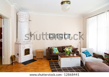 livingroom with a tile stove - stock photo