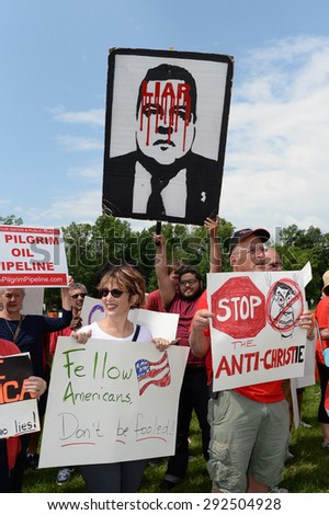 LIVINGSTON,NJ-JUNE 30:Protesters disapprove of New Jersey Gov. Chris Christie's decision to seek the Republican Nomination for President of the USA at Livingston,NJ High School,on June 30,2015. - stock photo