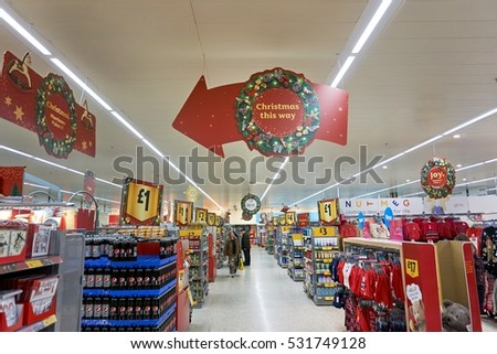 LIVINGSTON, SCOTLAND, UK - DECEMBER 6, 2016. Customers are shopping at Morrisons Supermarket during busy Christmas / New Year shopping time.