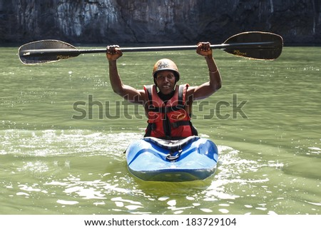 LIVINGSTONE - OCTOBER 01 2013: Extreme kayaker gets ready to attempt the mighty Zambezi river rapids in Livingstone, Zambia, Africa - stock photo