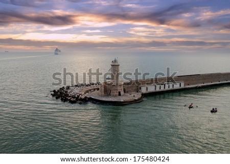Livorno harbor lighthouse - stock photo