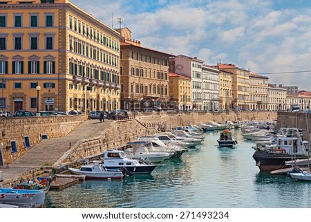 LIVORNO, ITALY - APRIL 14, 2015 - picturesque view of the canal with boats within the city, on April 14, 2015 in the town Livorno, Tuscany, Italy  - stock photo