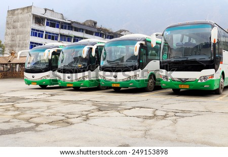 LIXIAN,CHINA -JAN 3,2015:row of green travel bus stop on the roadside. - stock photo