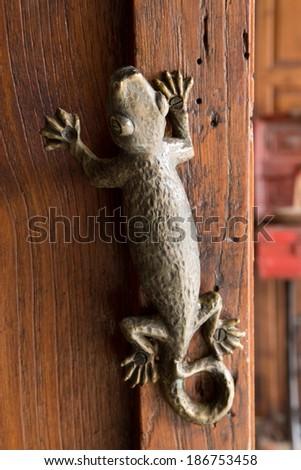 Lizard door knob - stock photo