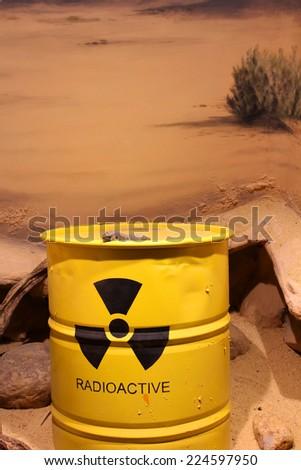 Lizard on a barrel of radioactive waste - stock photo