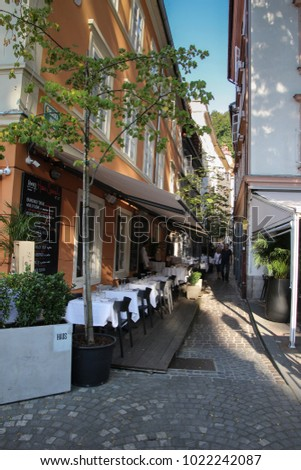 Ljubljana, Slovenia - August 18, 2017: Cosy restaurants and cafes in the center of the town seduce tourists to have a seat and relax
