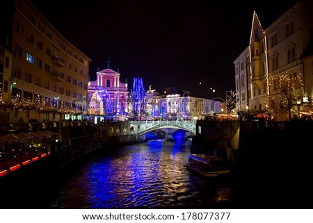 LJUBLJANA, SLOVENIA - DECEMBER 30: Preseren square and Ljubljanica river with holiday lightning for Christmas and New Year's eve celebration. Ljubljana, Slovenia, on December 30, 2013.