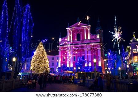 LJUBLJANA, SLOVENIA - DECEMBER 30: Preseren square in festive lightning in December for Christmas and New Year's eve celebration with entertainment program. Ljubljana, Slovenia, on December 30, 2013. - stock photo