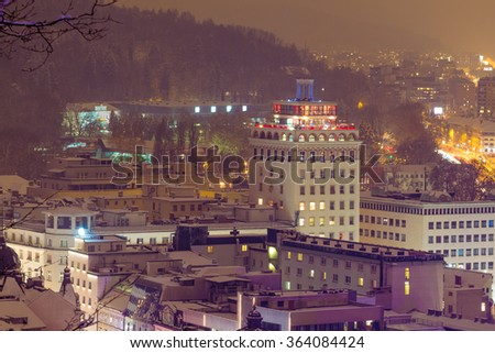 Ljubljana, Slovenia - January 3, 2016. Neboticnik skyscraper built in 1933, was one of the oldest and tallest high-rise buildings in Europe, night winter view.
