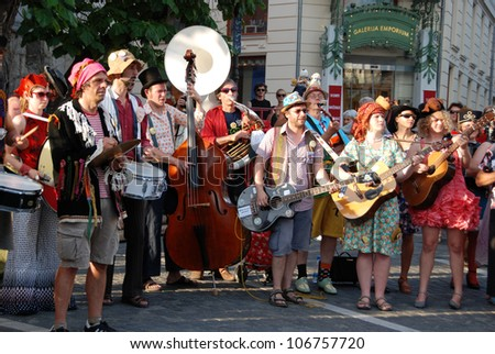 LJUBLJANA, SLOVENIA - JULY 1: Belgian brass band De Propere Fanfare Van De Vieze Gasten at traditional street theater festival Ana Desetnica on July 1, 2012 in Ljubljana, Slovenia.