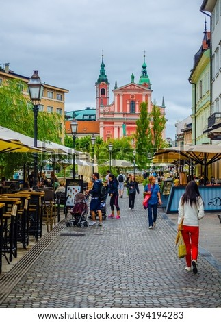 LJUBLJANA, SLOVENIA, JULY 29, 2015: Old town embankment in Ljubljana with the franciscan church of annunciation. Ljubljana is the business and cultural center of the country.