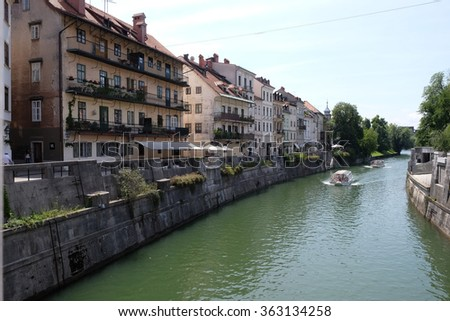 LJUBLJANA, SLOVENIA - JUNE 30: City centre, view on the river. Ljubljana is the business and cultural center of the country, Ljubljana, Slovenia on June 30, 2015
