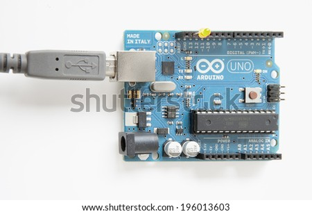 LJUBLJANA, SLOVENIA - JUNE 1, 2014: Photo of a popular Arduino single-board microcontroller with attached USB cable and LED performing basic programming example.