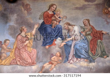 LJUBLJANA, SLOVENIA - JUNE 30: Virgin Mary with the baby Jesus surrounded by saints and angels, fresco in the Franciscan Church of the Annunciation in Ljubljana, Slovenia on June 30, 2015 - stock photo