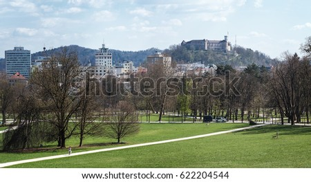 LJUBLJANA , SLOVENIA - MARCH 30, 2017: Photo showing the Tivoli park in Ljubljana with the panorama of Ljubljana in the background; on the promenade a police trailer with horses can be observed.