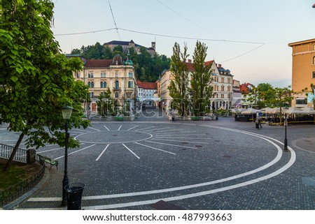 LJUBLJANA, SLOVENIA - 27TH MAY 2016: A view towards Town Square, Ljubljana Castle and Triple bridges during the morning from Preseren Square. Buildings and people can be seen.