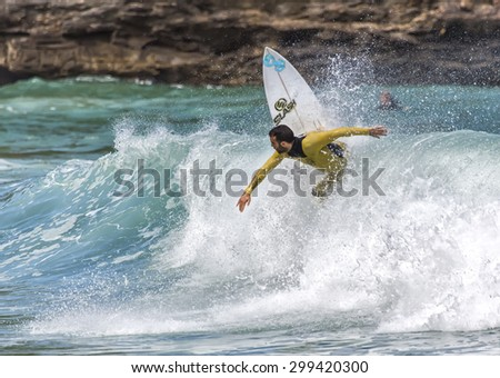 LLANES, SPAIN  May, 2015: Surfers participating in the CACONTEST 2015 on Ballota beach located in Asturias, in the north of Spain. May, 16, 2015