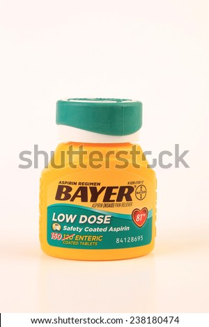 LLANO, TEXAS-DEC 16, 2014:  The low dose aspirin is highly recommended by many doctors for reducing risk of heart attack and stroke.  It is also for pain relief and reducing fever in children. - stock photo