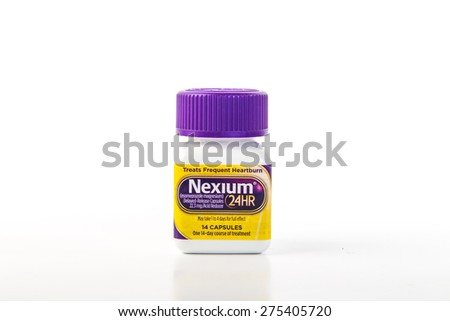 "LLANO, TEXAS-MAY 5, 2015:  Bottle o Nexium 24HR isolated on white background.  The ""Purple Pill"" relief from frequent heartburn and acid reflux."
