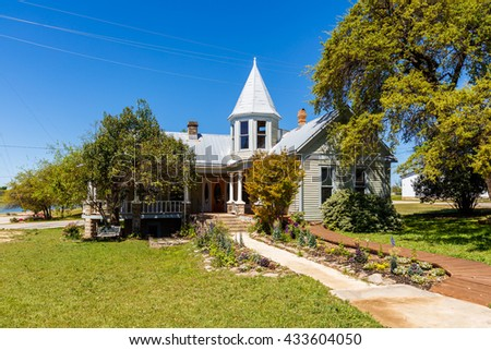 Llano, Texas USA - April 3, 2016: Beautiful Victorian style historical home in this small Texas town in the hill country.