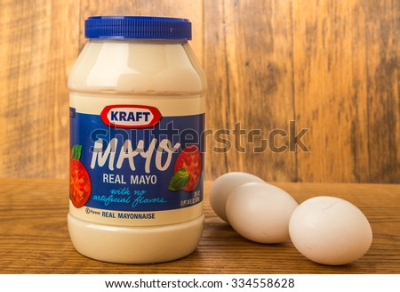 """LLANO, TX-NOV 2, 2015:  Kraft Mayo and eggs against rustic wooden wall to emphasize its """"down home"""" real Mayonnaise logo. - stock photo"""