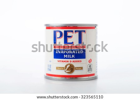 LLANO, TX-OCT 3, 2015: Can of PET evaporated milk against white background with copy space.  A kitchen staple for many years. - stock photo