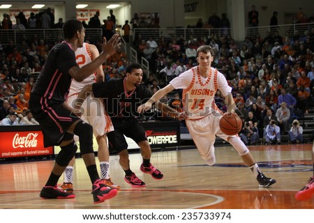 LLEWISBURG, PA. - NOVEMBER 28: Bucknell's #14 Chris Hass drives to the basket l during a basketball game against Penn Statel on November 28, 2014 Sojka Pavilion in Lewisburg, PA. - stock photo