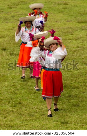 Lloa, Ecuador - 21 December 2011: Group Of Ecuadorian Dancers Dressed Up In Traditional Costumes Dancing For The Spring Festival In Lloa On December 21, 2011 - stock photo