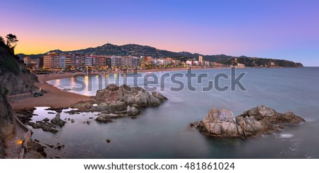 LLORET DE MAR, SPAIN - JUNE 23, 2016: Panorama of Lloret de Mar Seafront in Catalonia, Spain. Lloret de Mar is most popular Costa Brava resort and located only 75 km from Barcelona.