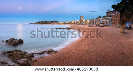 LLORET DE MAR, SPAIN - JUNE 21, 2016: Panorama of Lloret de Mar Seafront in Catalonia, Spain. Lloret de Mar is most popular Costa Brava resort and located only 75 km from Barcelona.