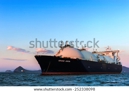 LNG carrier Grand Aniva at sunset on the roads of the port of Nakhodka. Far East of Russia. East (Japan) Sea. 31.03.2014 - stock photo