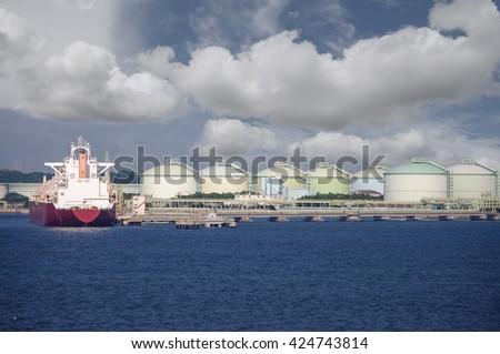LNG Gas tanker loading in port - stock photo